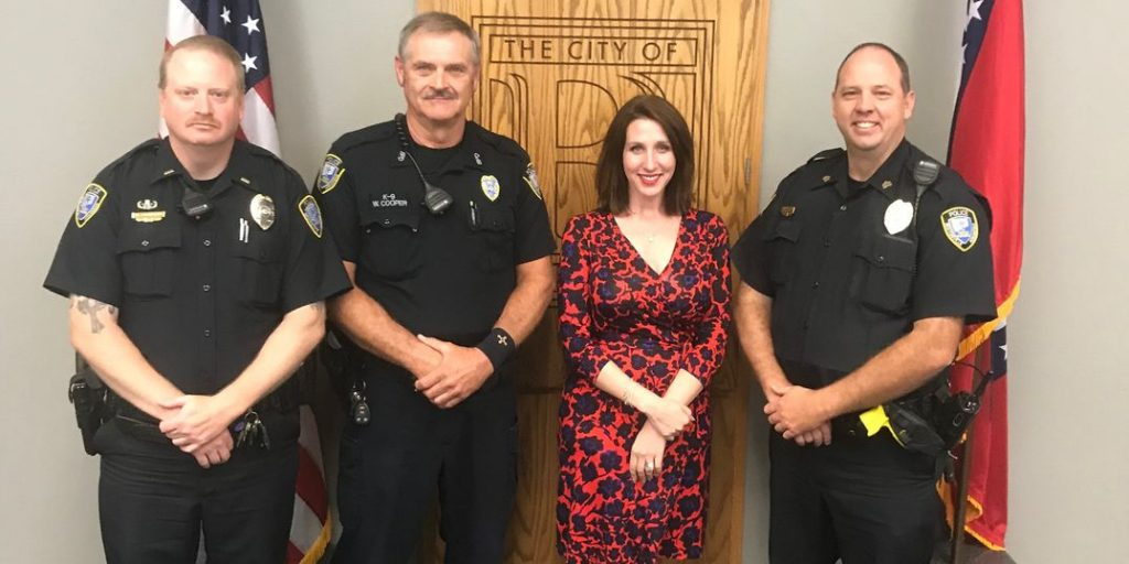 Mary Schulz and Bentonville Police Officers